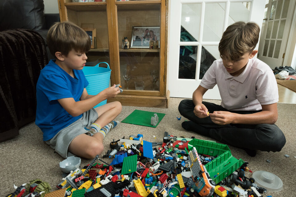 Autistic boy and brother playing with lego.