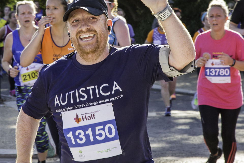 Autistica runner finishing the Royal Parks half marathon